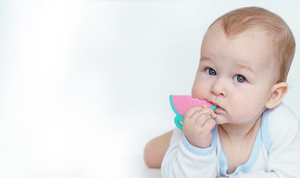 Baby chewing a teething toy